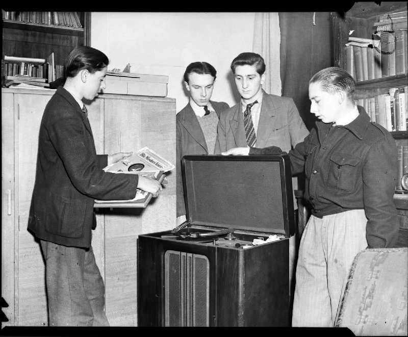 Picture: Boys at the Canterbury Club, part of the Oxford and Bermondsey Boys Club, listening to records on the club's radiogram in 1944. Imperial War Museum - sourced from Wikimedia Commons - public domain.